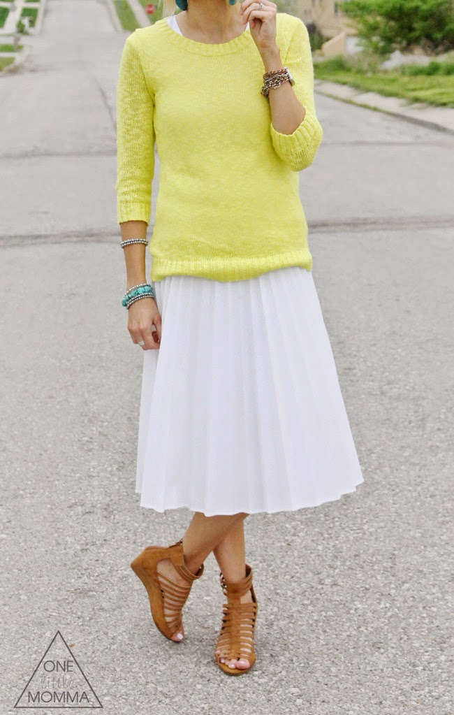 Citron, teal accessories and a white pleated skirt