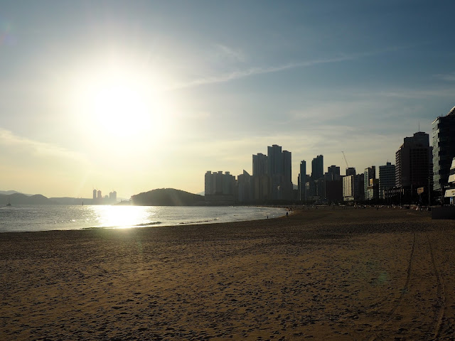 Late afternoon sunlight with silhouettes of buildings at Haeundae beach, Busan, South Korea