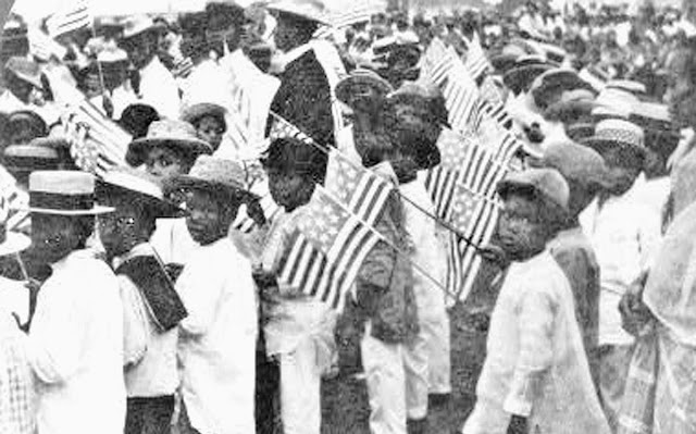 Original caption:  Young Filipinos in holiday attire.  Image source:  United States National Archives.