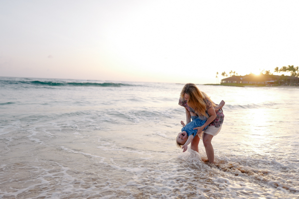 playing in the waves at sunset - a magical moment from our family vacation to Kauai