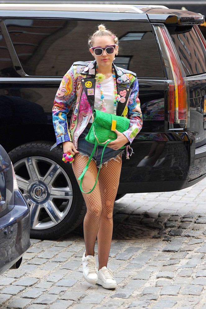 Miley Cyrus flaunts legs in mesh tights out and about in NYC