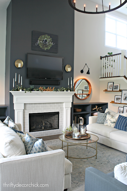 Dark blue fireplace wall with built ins