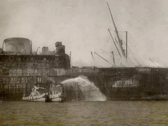 Troopship MV Georgic burning in Suez Harbor 14 June 1941 worldwartwo.filminspector.com
