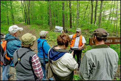 Stan Hess leads walk on sustainable forestry trail