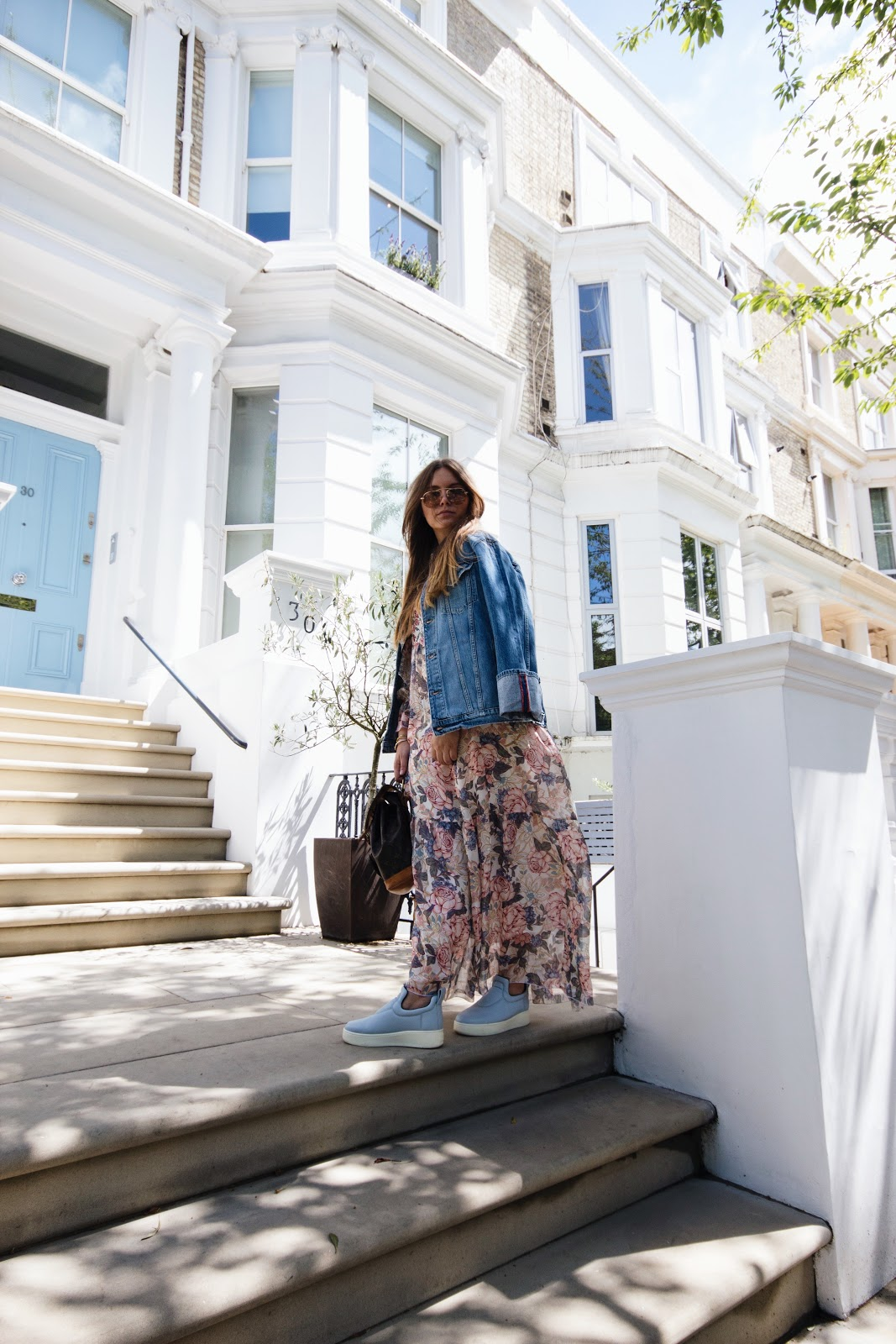 fashion blogger deau dominique candido wearing a see by chloe dress, prada teddy sunglasses, celine sneakers, frame denim jacket and a louis vuitton backpack