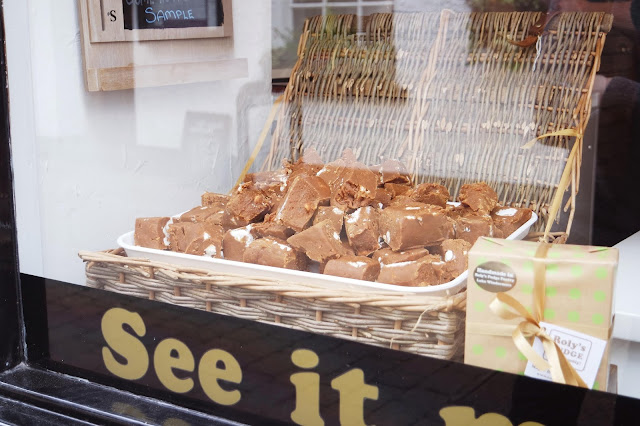 a basket of fudge in the window of a shop