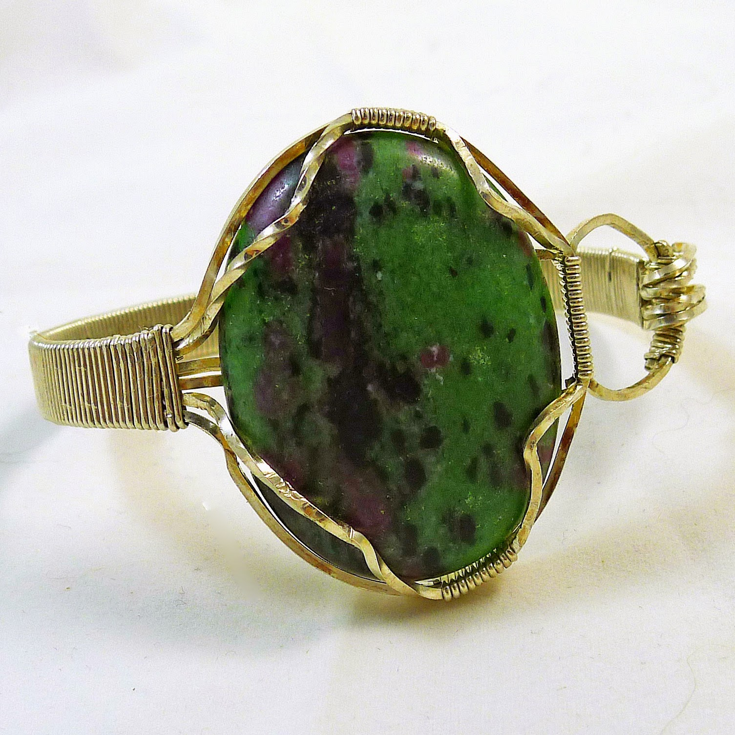 http://www.shazzabethcreations.co.nz/#!product/prd1/2228422911/ruby-in-zoisite-sterling-wired-bangle