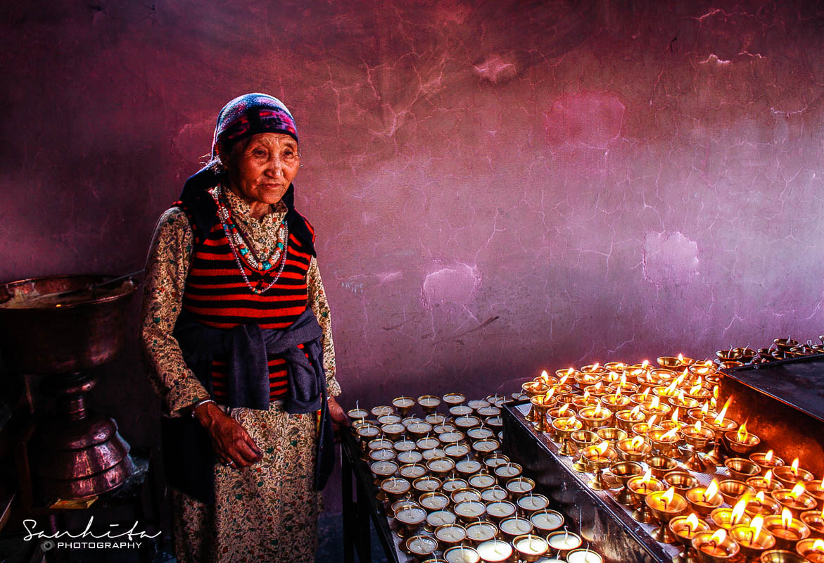 An old lady selling candles