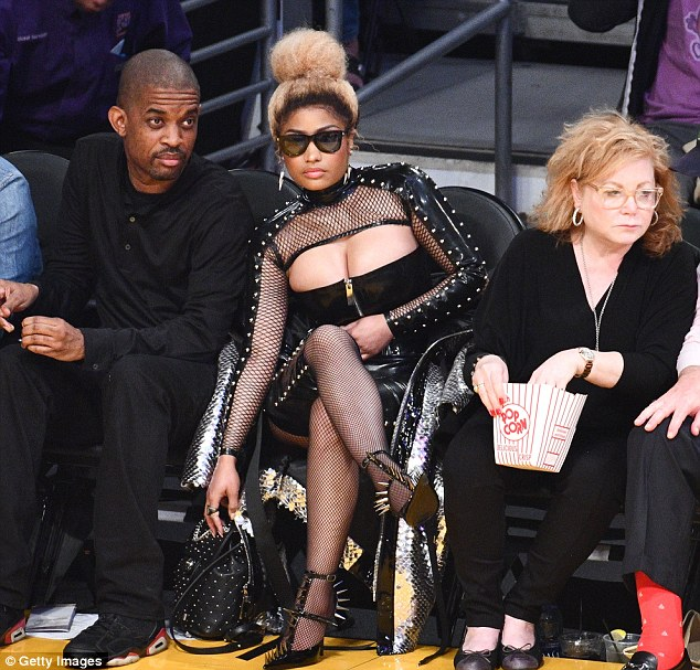 Nicki Minaj flashes cleavage sexy black leather ensemble at Los Angeles Lakers game