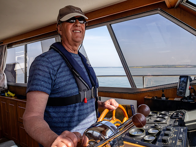 Photo of Phil at the helm of Ravensdale