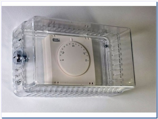 Thermostat cover lockable
