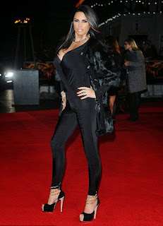 Some cold weather didn't stop Katie Price from wearing a revealing outfit. The 36-year-old stole the show at Hunger Games premiere at London on Monday, November 10, 2014.in her daring combine of jumpsuit that revealed, well, a ton of wonderful anatomy.