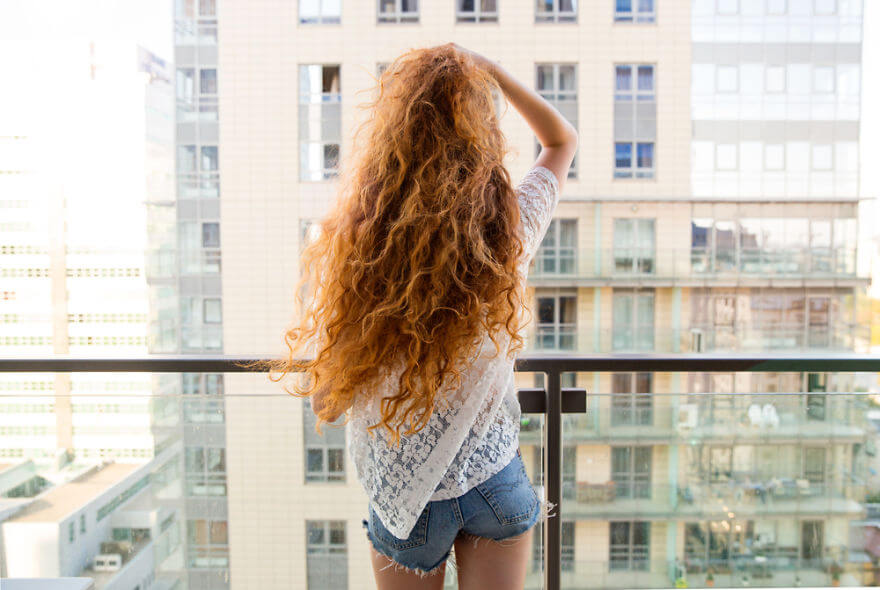 30 Stunning Pictures From All Over The World That Prove The Unique Beauty Of Redheads - Beata Overlooking Downtown Warsaw