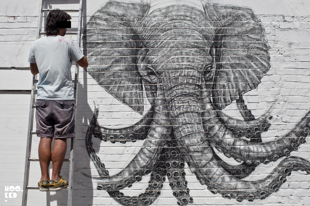 Street Artist Alexis Diaz at work on his London mural