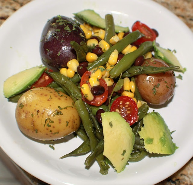 this is a 4th of July salad with red white and blue potatoes southwest style potato salad . This is made with corn, beans, tomatoes and avocado