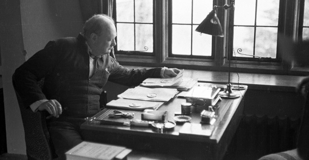Winston Churchill at his desk in 1939: a prolific writer, he covered scientific topics as diverse as evolution and fusion power. Credit: Kurt Hutton/Picture Post/Getty