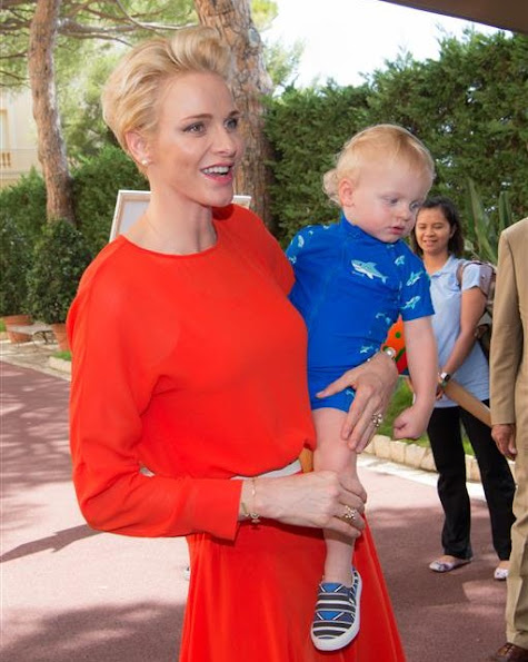 Prince Albert, Princess Charlene, Prince Jacques, Princess Gabriella of Monaco. Princess Charlene Armani Prive Dress, Jeweler diamond earrings, royal fashions, style
