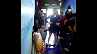Maine using Alden's hoverboard at the Broadway