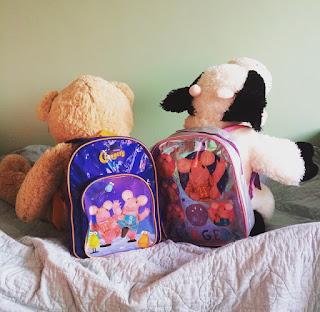 Cuddly toys wearing Clangers Rucksacks