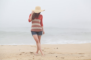 Light weight sweater worn with shorts on the beach.