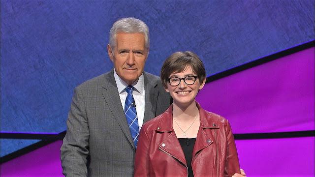 Trinity graduate Olivia Ochoa with Jeopardy host Alex Trebek