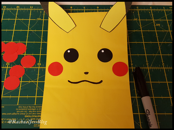 Adding the finishing touches to Pikachu's party bag