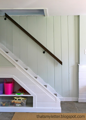 stained handrail against grey owl paint