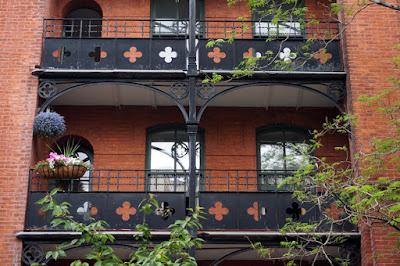 Black metal balcony hallways with hanging plants