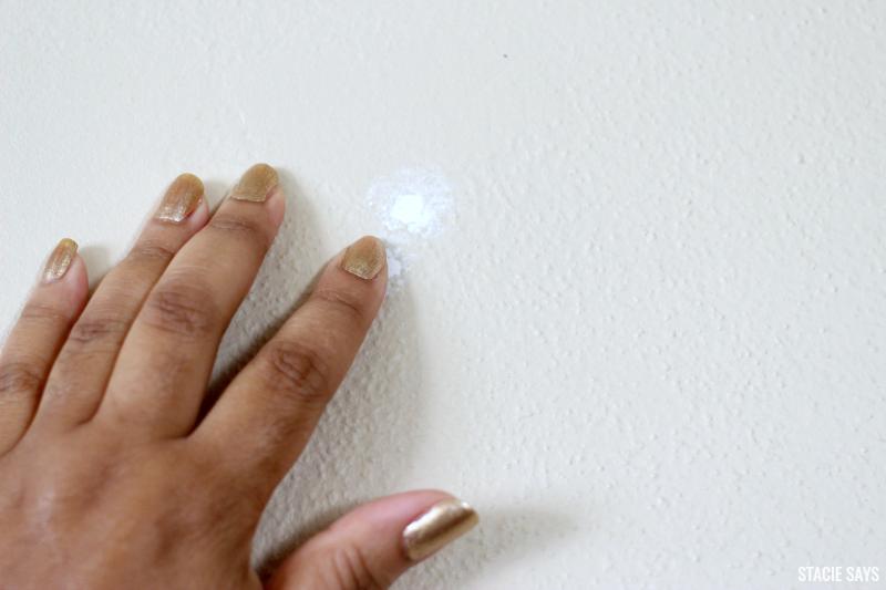 filling a nail hole with cauk