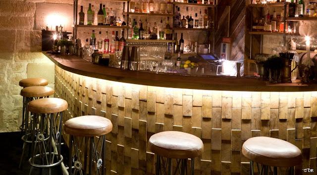 basement bar design ideas with wine racks and basment liquor shelves