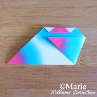 Folding side of paper shape