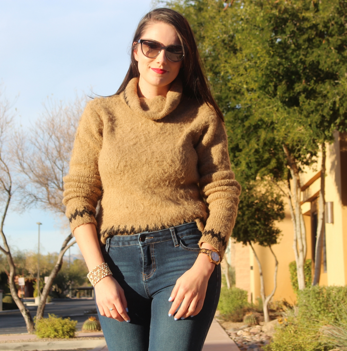 This is a close up of the top half of my body, featuring my Jimmy Choo sunglasses and a tan ASOS sweater.
