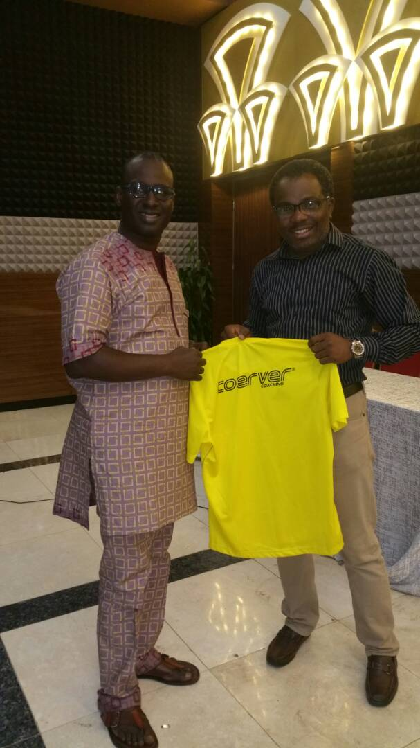 Mr. Sola Ogunnowo COO, Nationwide League One (NLO) with the Coerver Coaching jersey with Mr. Yomi Kuku, ED, Search and Groom youth for development centre, country representative of Coerver Coaching.