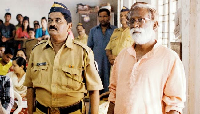 A police constable brings Narayan Kamble to the court, in Court, Directed by Chaitanya Tamhane