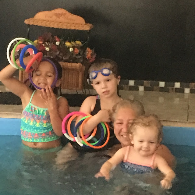 Linda B. and three of her granddaughters in the Original Endless Pool where she taught them all to swim