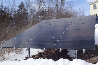 Solar panels provide power to Spicer Art Conservation, an art conservation studio located in upstate New York specializing in textile, objects, paper and upholstery conservation, green company, solar power