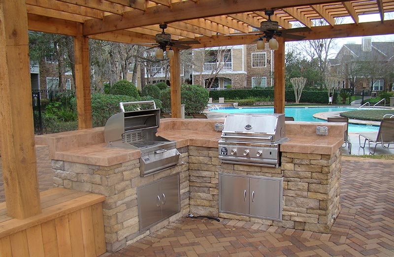 Wooden pergola creatuve garden structures al farah for Cedar outdoor kitchen cabinets