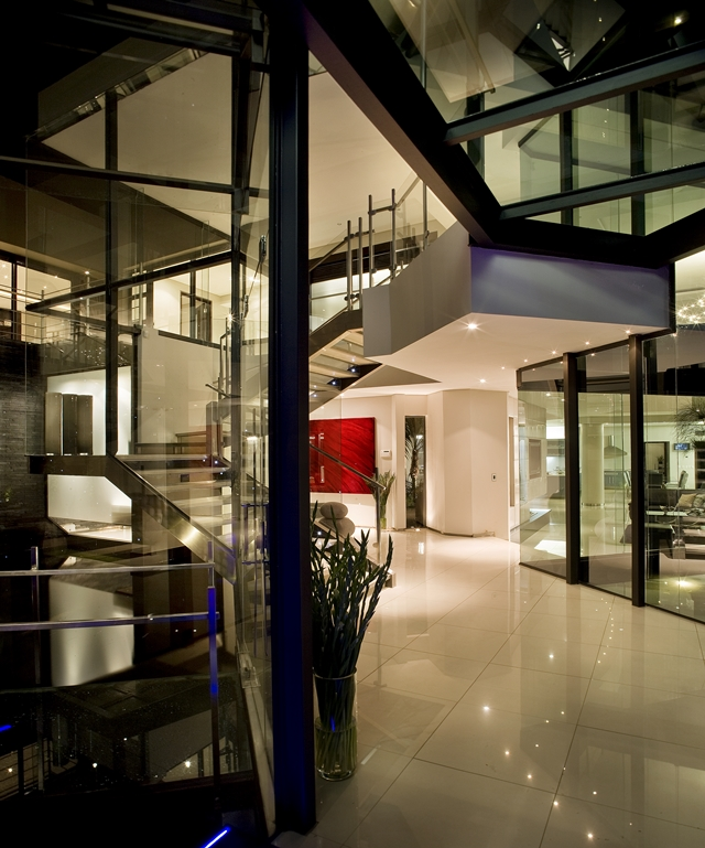 Steel and glass staircase in the hallway