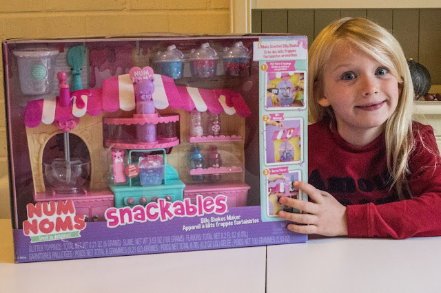 The Silly Shakes Maker in it's box with a 7 year old posing next to it