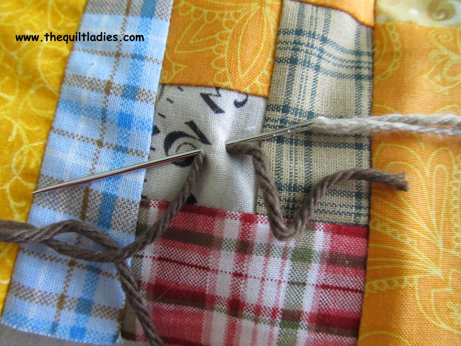 Tutorial on how to tie a quilt with yarn and a needle.