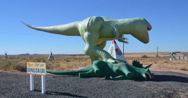 Better understanding of planetary motions' role in driving natural climate swings may lead to breakthroughs in the study of evolution. At a tourist stop near Petrified Forest, dinosaurs clash. Credit: Kevin Krajick/Lamont-Doherty Earth Observatory