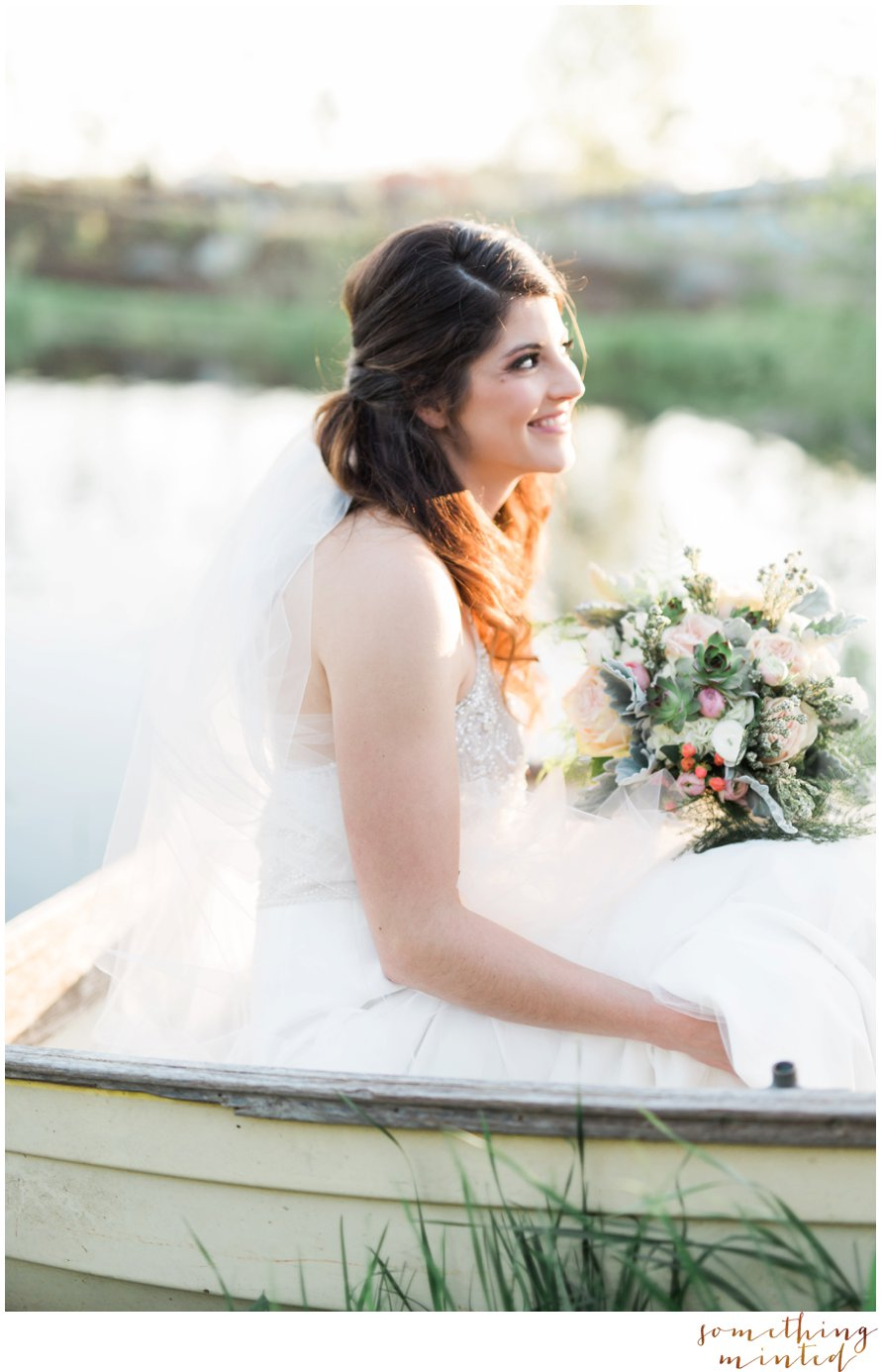 Bride in a canoe photography by Something Minted