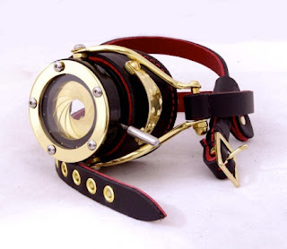 Leather and brass metal steampunk monocle with working brass iris aperture lens like a camera with open and close shutter lever, for costume and cosplay