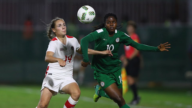 Emma Rose Regan of Canada tries to tackle Chinaza Love Uchendu of Nigeria