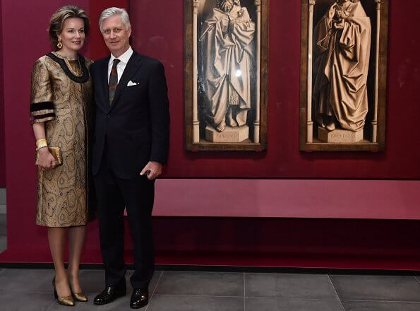 Queen Mathilde wore a coat from Autumn Winter 2016-2017 collection of Dries Van Noten. Queen wore a white satin midi dress by Natan