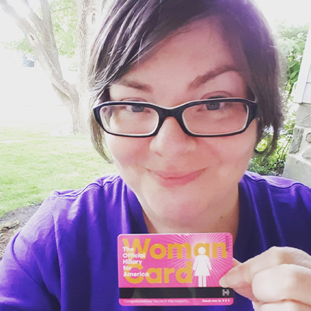 image of me holding up an official Hillary Clinton Woman Card