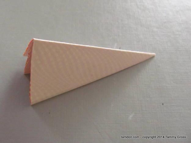 turn so fold is facing upward