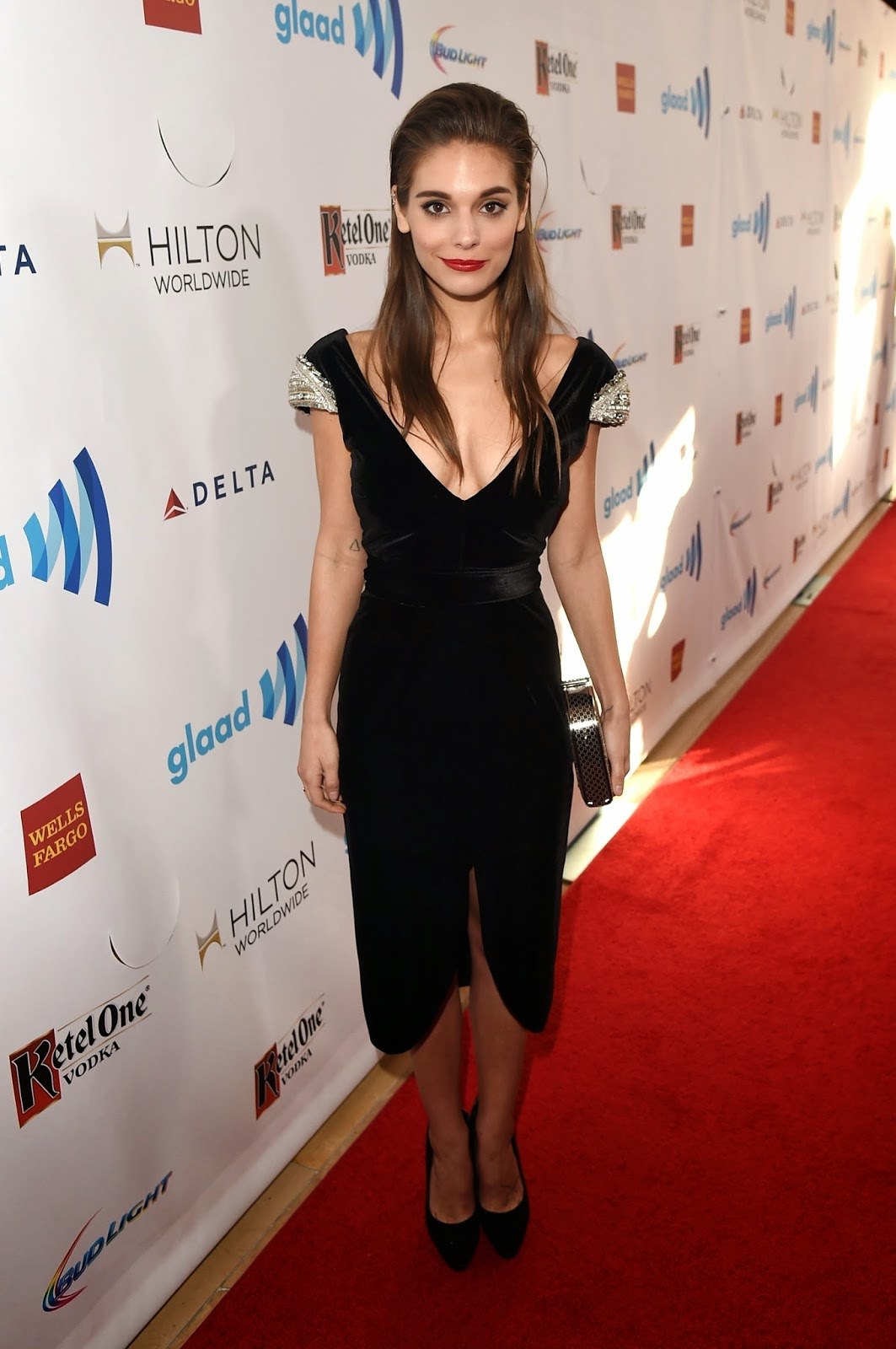 Caitlin Stasey shows off cleavage at the 2014 GLAAD Media Awards in LA