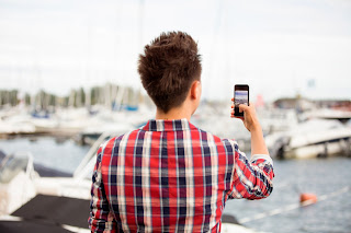 Man takes photo with smartphone