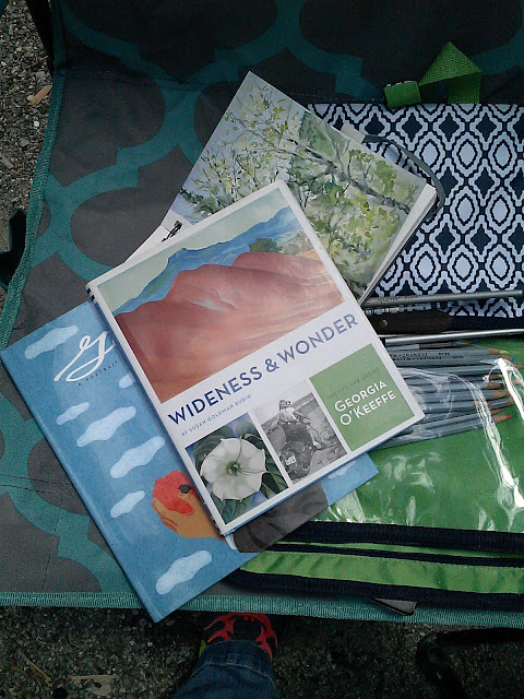 travel watercolor art kit and books for reading Christy Sheeler Artist